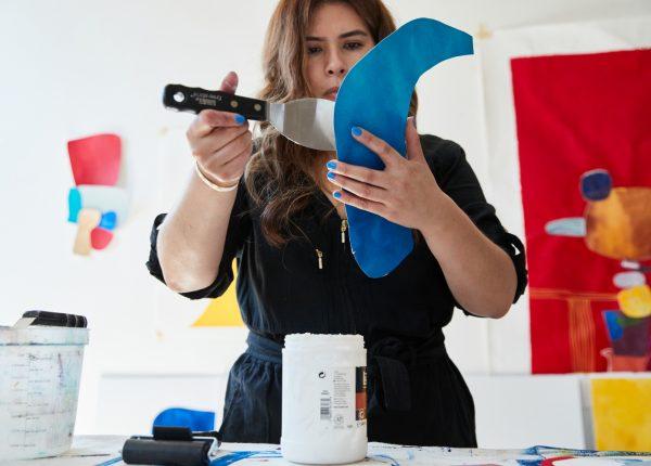 Cynthia working in the art studio