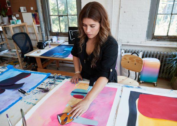 Cynthia working with acrylic mediums the art studio