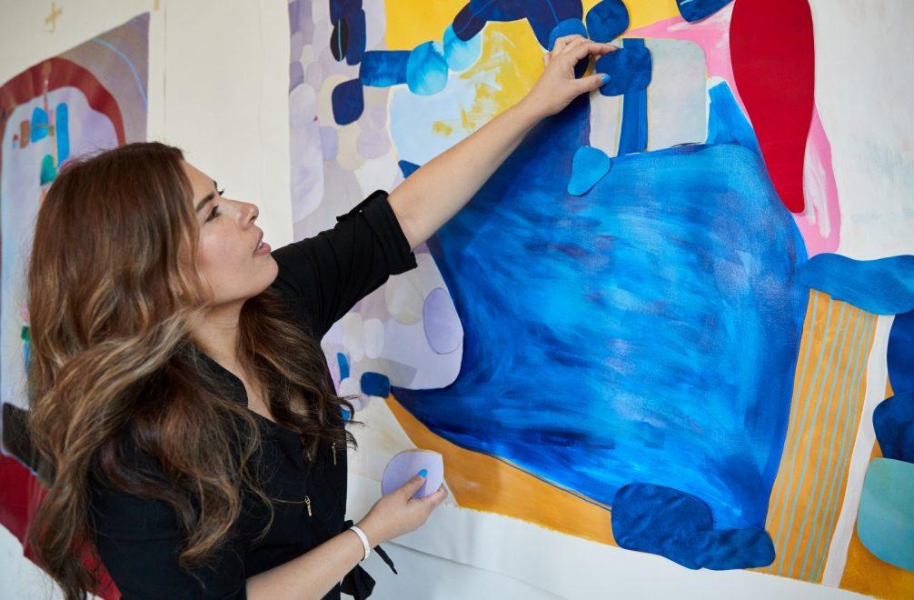 Cynthia creating with acrylic mediums the art studio