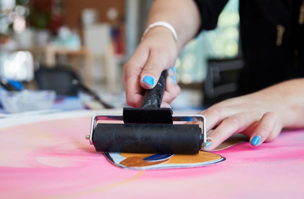 Cynthia rolling with acrylic mediums the art studio