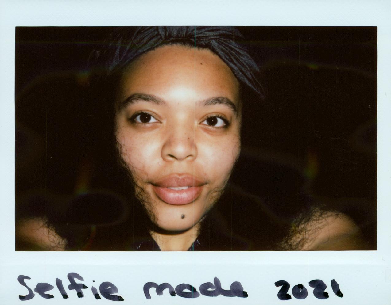 Artist Spotlight Polaroid of Sade DuBoise