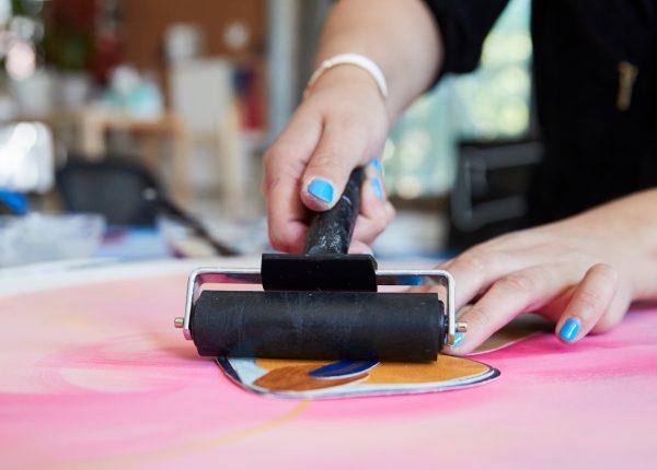 Cynthia rolling with acrylic mediums