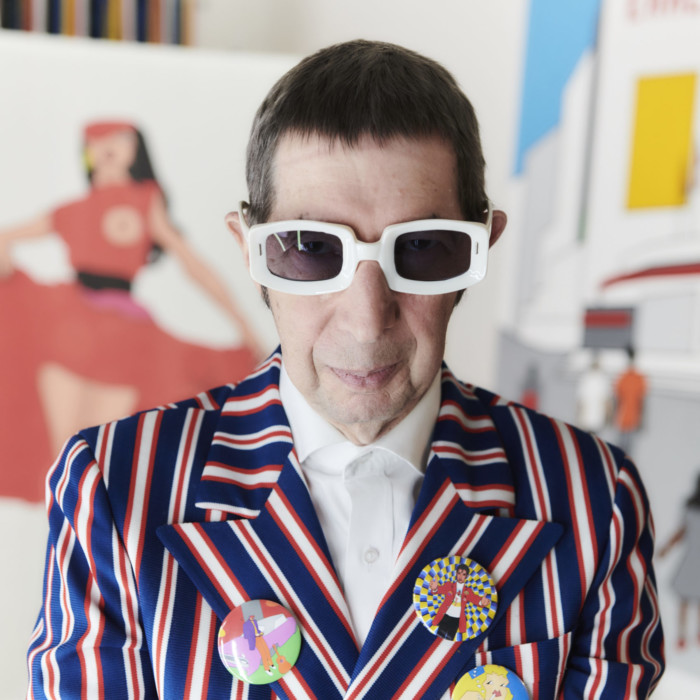 Colourful profile image of artist Duggie Fields in his studio